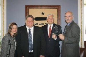 US Congressman and Chairman Pete Sessions (R-TX) receives SWTA's Legislator of the Year Award from Steve Salin, Vice President of Rail Planning, DART, Ken Savage, SWTA President, and Kristen Joyner, Executive Director